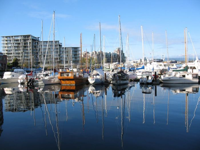 Calm reflections in the water of the Inner Harbour, Victoria, BC