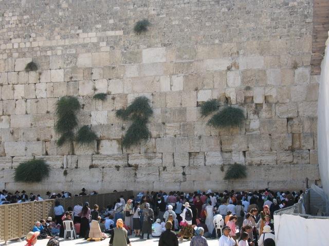 People pray at the most powerful symbol of enduring Judiasm.
