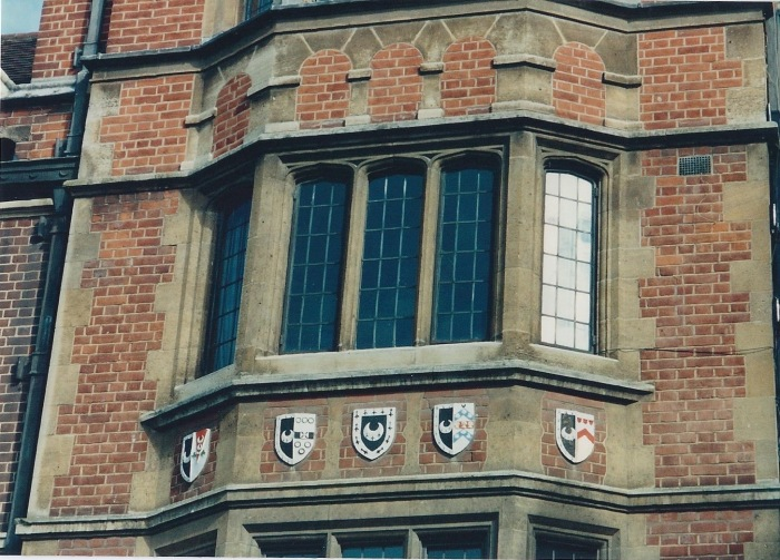 Window at Trinity Hall. Emblems are various groups of Canon Law students through the years.