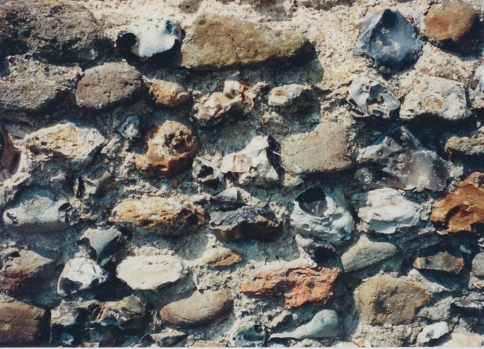 Closeup of a wall at Clare Castle-random stones in cement.