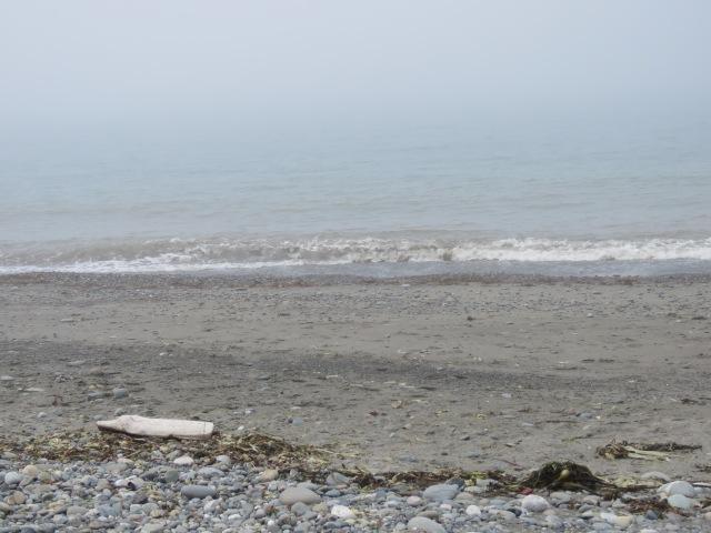 Rocks sand surf